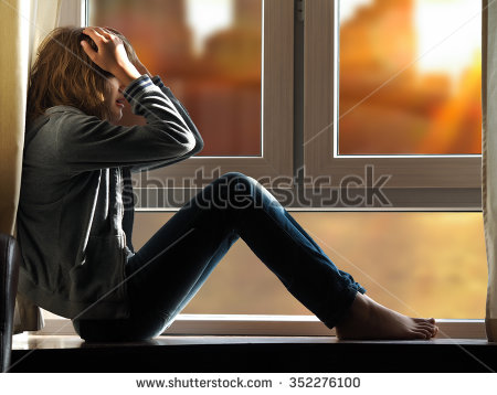 stock-photo-lots-of-sun-sunrise-girl-sits-on-the-window-woman-blinded-by-the-sun-girl-holding-her-head-352276100
